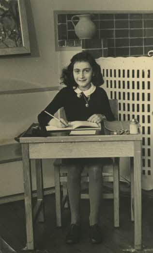 Photo of Anne Frank: Victim of the Holocaust and author of a diary