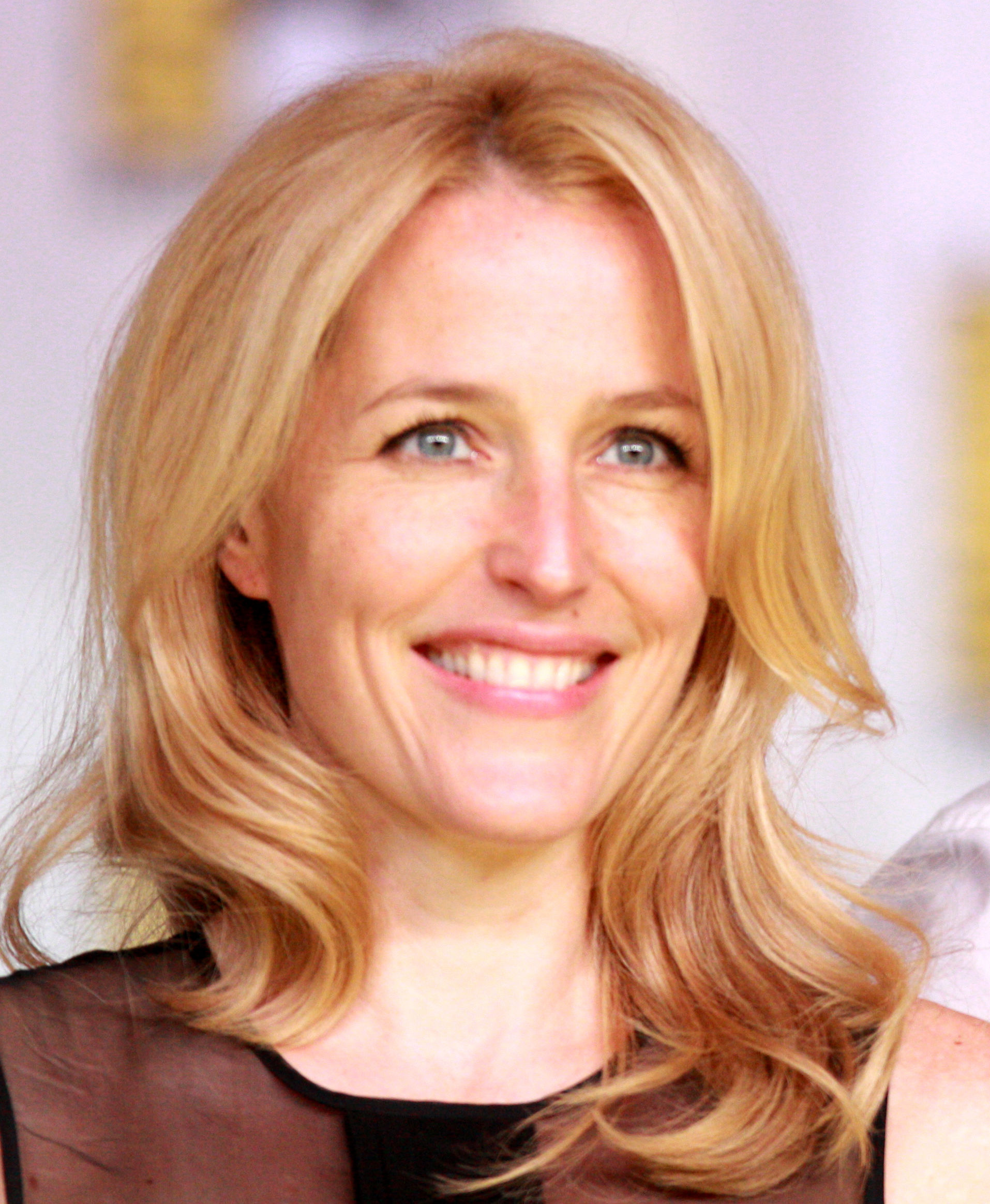 Photo of Gillian Anderson: American-British film, television and theatre actress, activist and writer