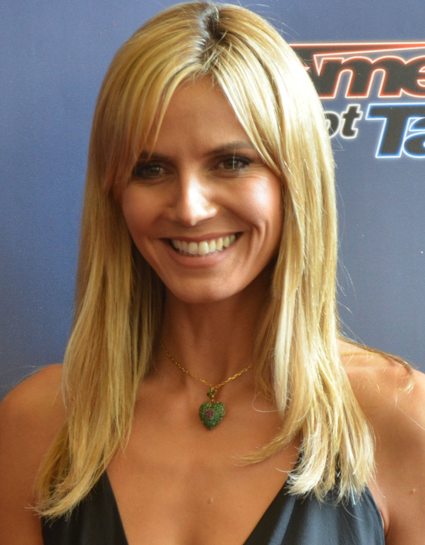 Photo of Heidi Klum: German model, television host, businesswoman, fashion designer, television producer, and actress