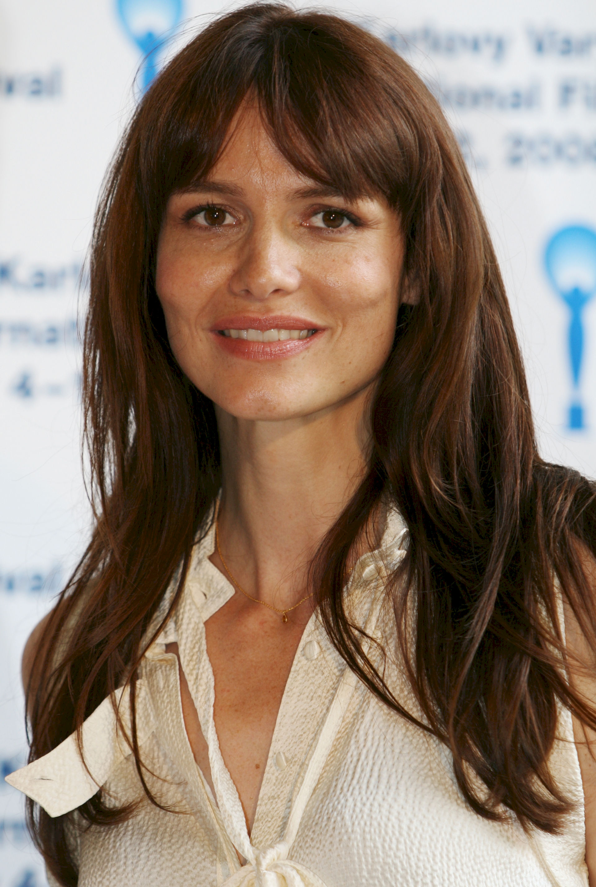 Photo of Saffron Burrows: English actress, model and writer