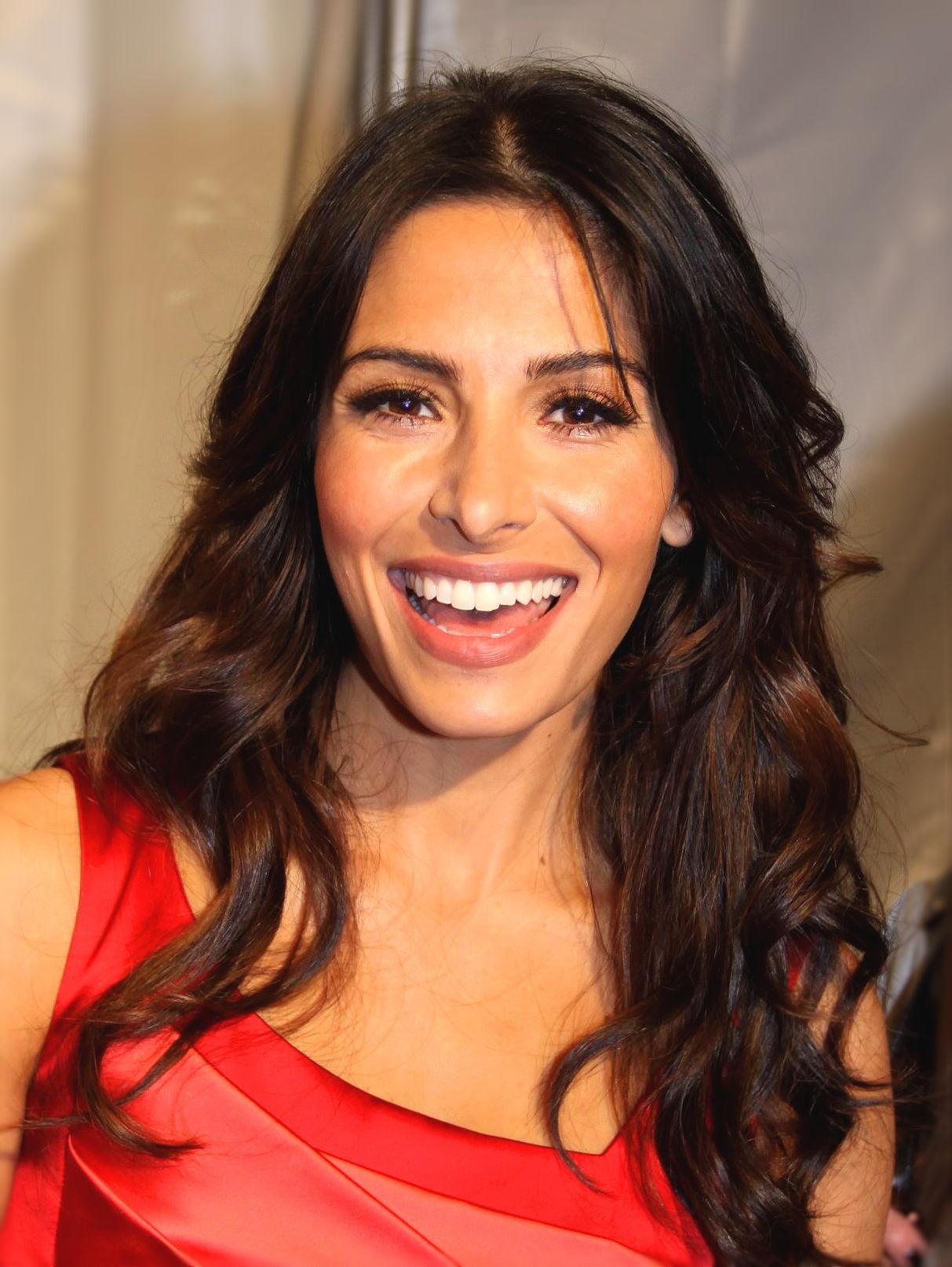 Photo of Sarah Shahi: American television actress and former NFL Cheerleader