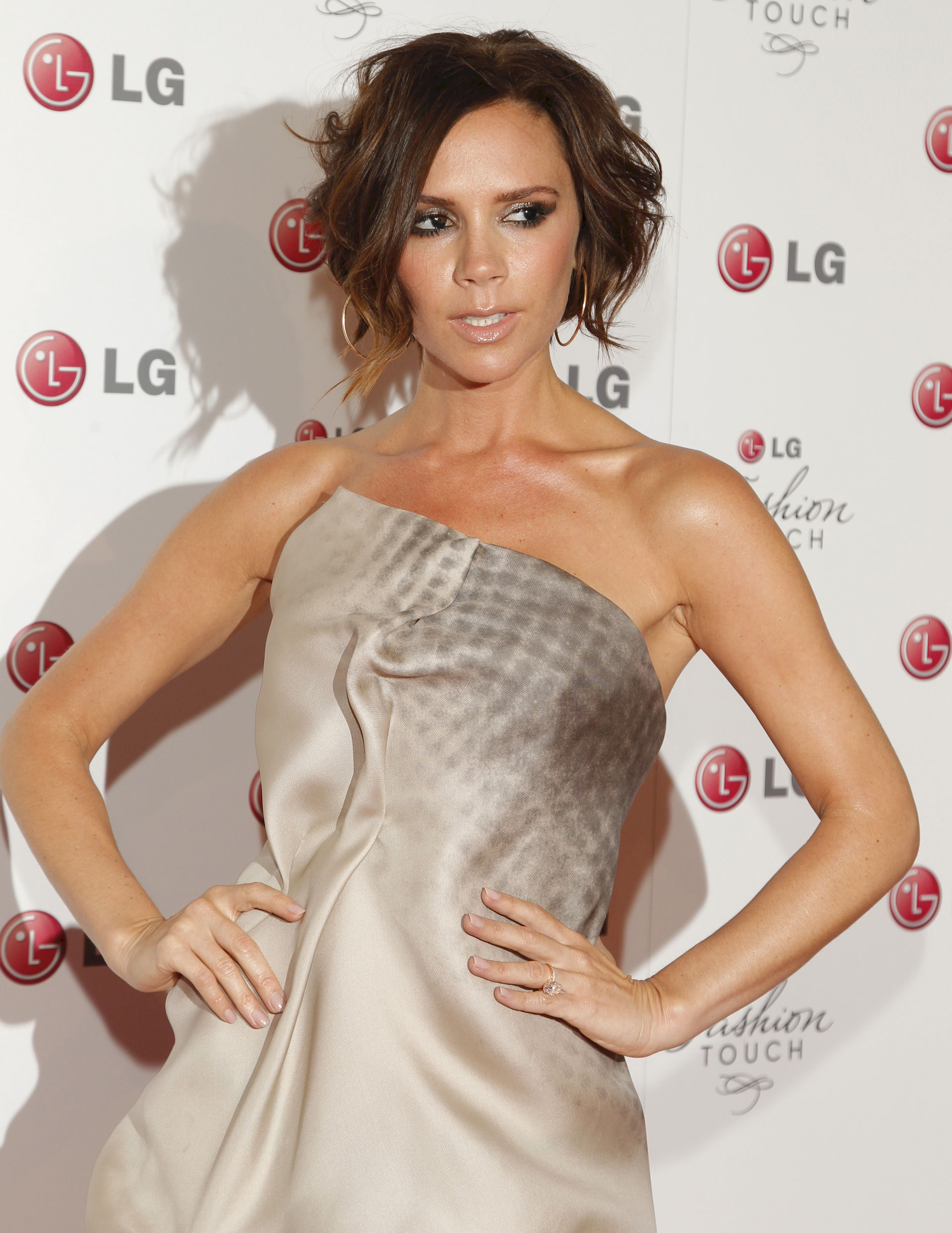 Photo of Victoria Beckham: English businesswoman, fashion designer and singer